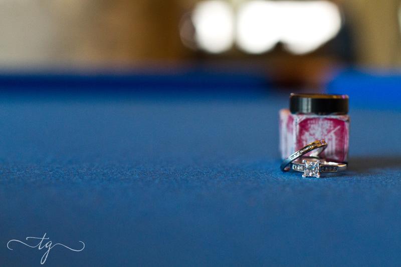 wedding ring detail photo on pool table at Aloft Hotel Dallas
