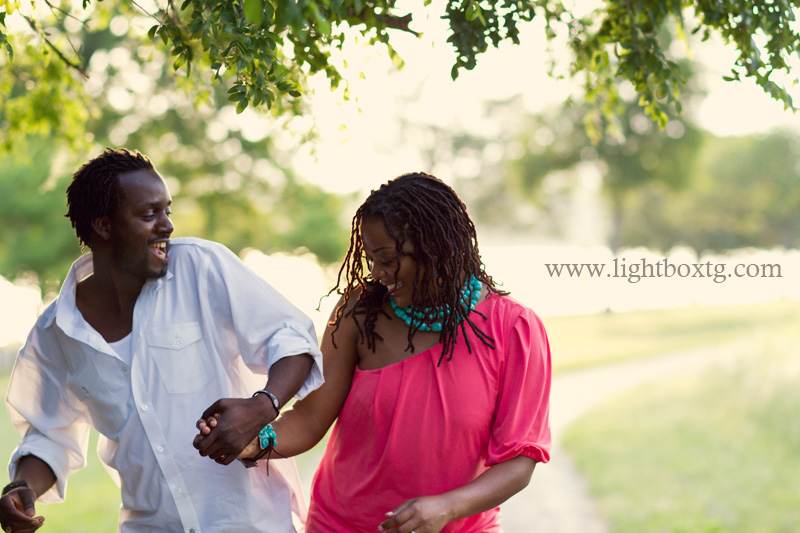 couple dancing and laughing together during engagement photo session in Dallas