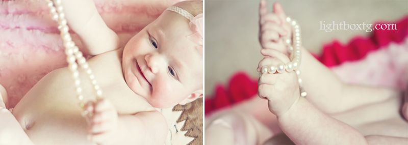 sweet baby plays with pearls on blanket copy